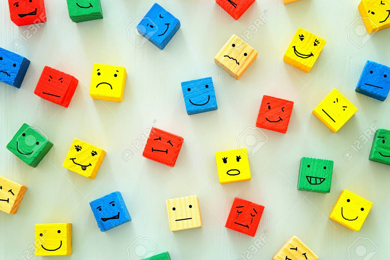 concept of Different emotions drawn on colorfull cubes, wooden background. - 113499354
