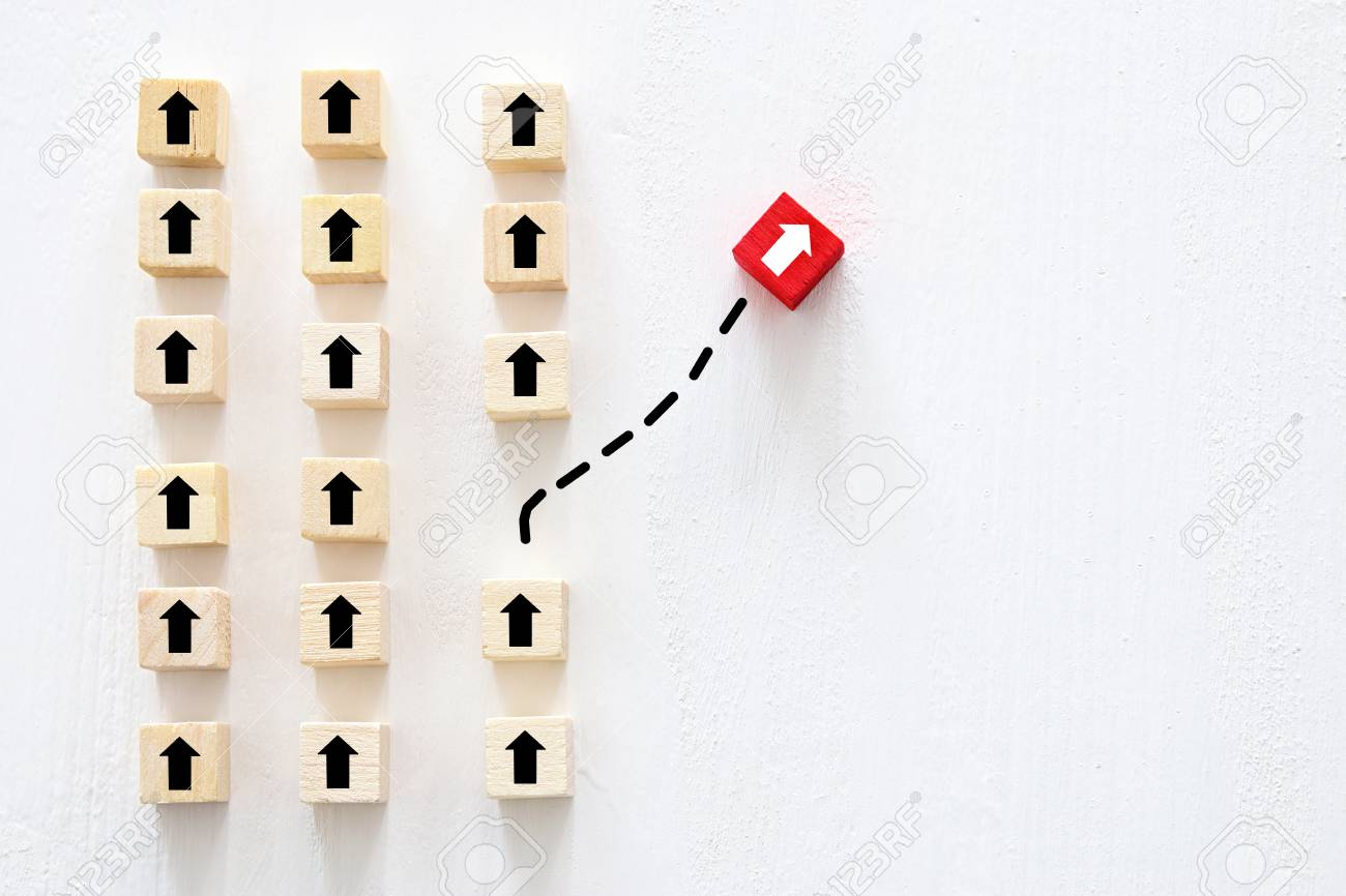Concept of think different, innovation and creativity. Red cube changing direction from others - 114466351