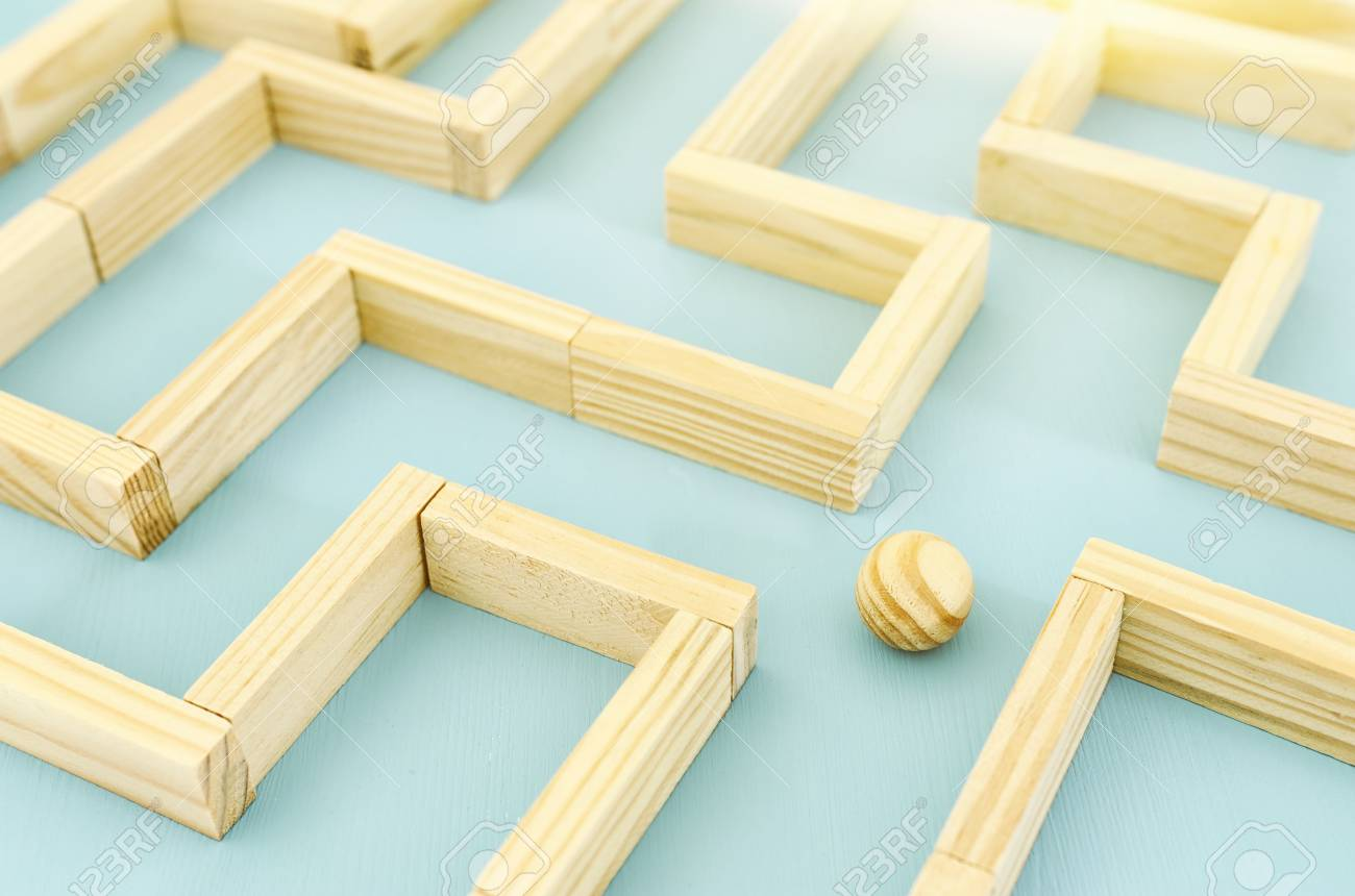 concept photo of standing in a maze and looking for the best way or solution - 114636588