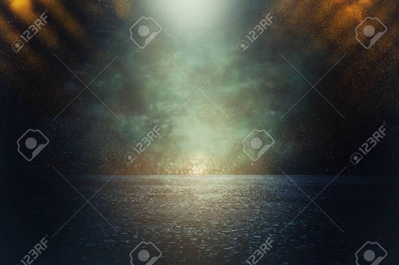 Spotlight over concrete floor. Dark black background - 116261767
