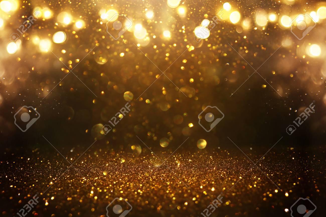 Glitter vintage lights background. Black and gold. De-focused - 120237992