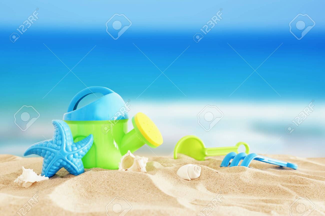 Vacation and summer image with beach colorful toys for kid over the sand - 125185075