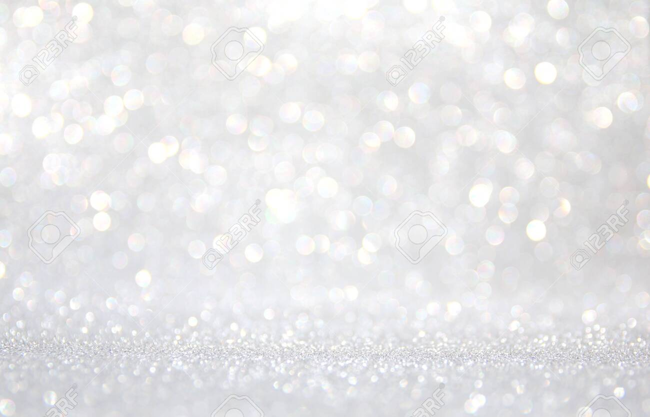 background of abstract glitter lights. silver and white. de-focused - 128389642