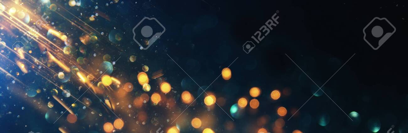 background of abstract glitter lights. blue, gold and black. de focused. banner - 128926393