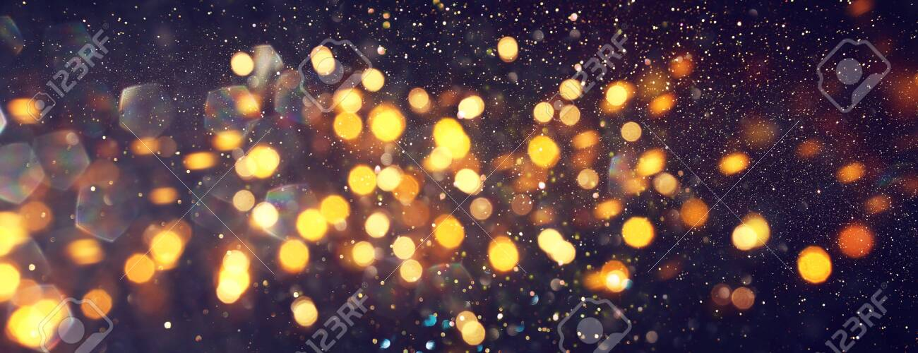 background of abstract glitter lights. gold and black. de focused. banner - 130268684