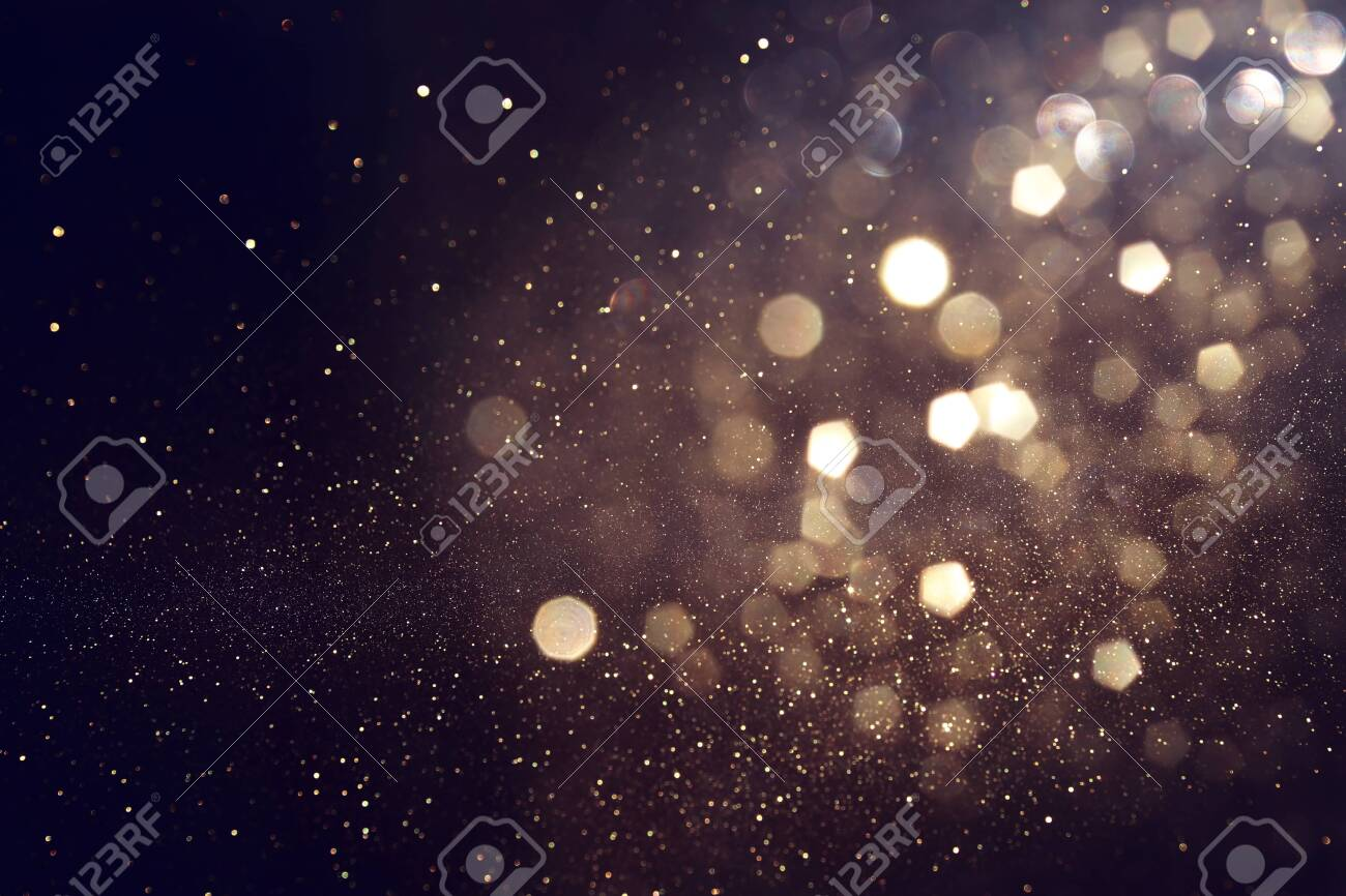 background of abstract glitter lights. gold and black. de focused - 132318314