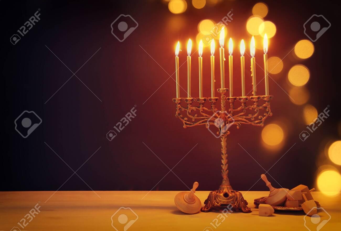 Religion image of jewish holiday Hanukkah background with menorah (traditional candelabra) and dreidels - 133147582