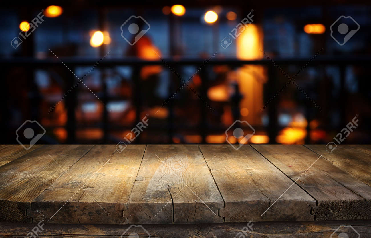 background Image of wooden table in front of abstract blurred restaurant lights - 137390440