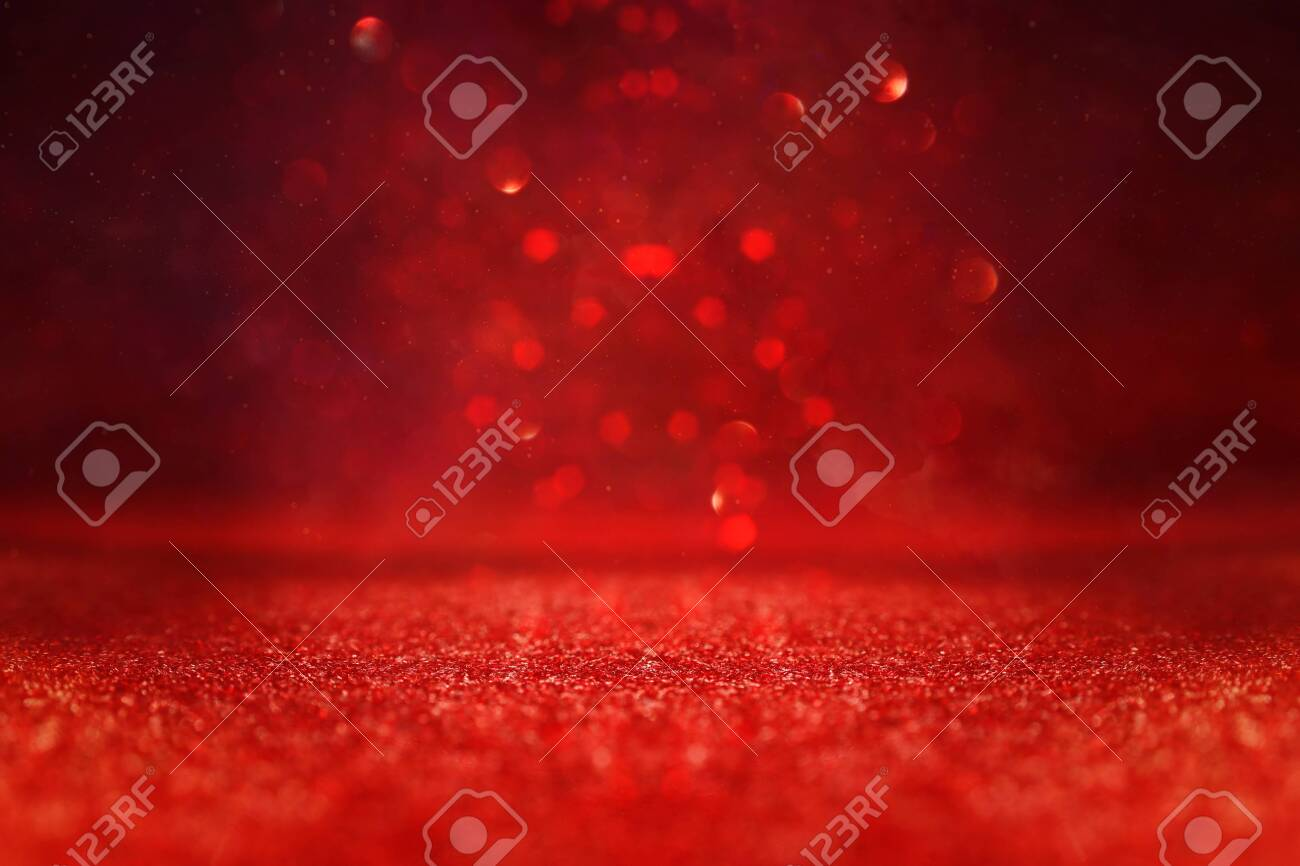 background of abstract red, gold and black glitter lights. defocused - 140119059