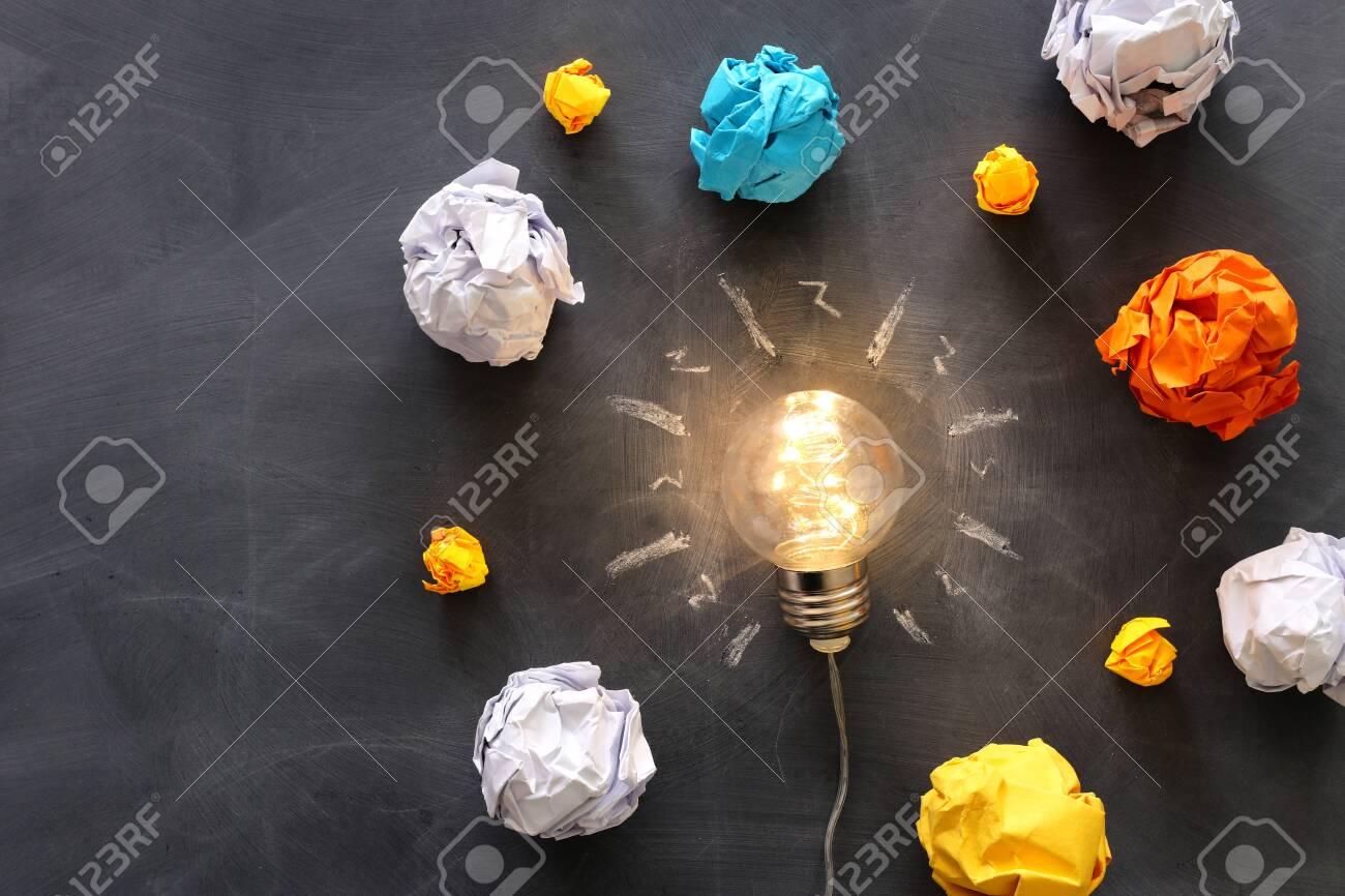 Education concept image. Creative idea and innovation. Light bulb as metaphor over blackboard - 147851958