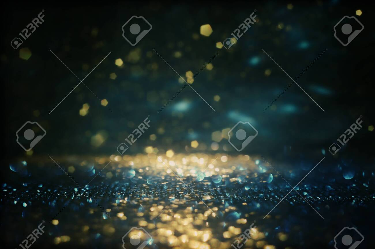 background of abstract glitter lights. gold, blue and black. de focused - 149541312