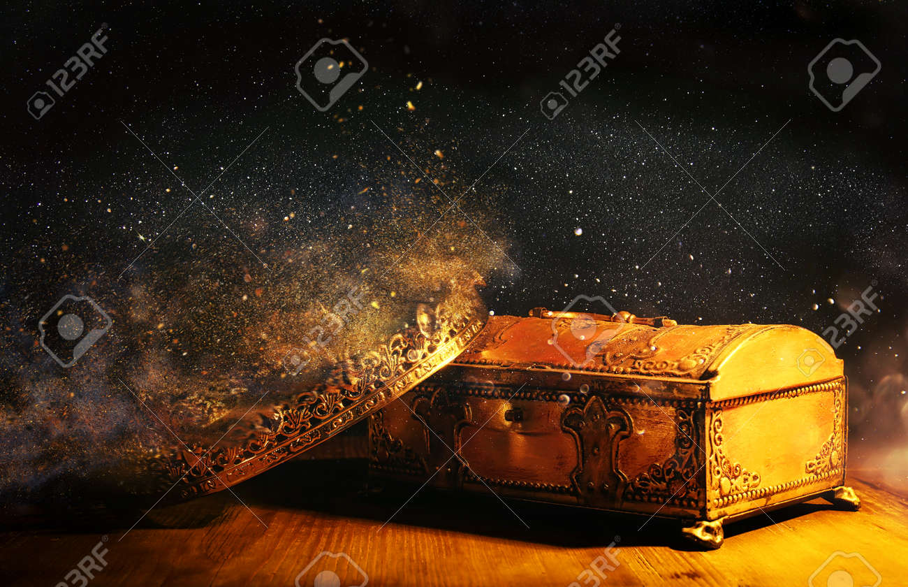 low key image of beautiful queen/king crown over gold treasure chest. vintage filtered. fantasy medieval period - 168934731