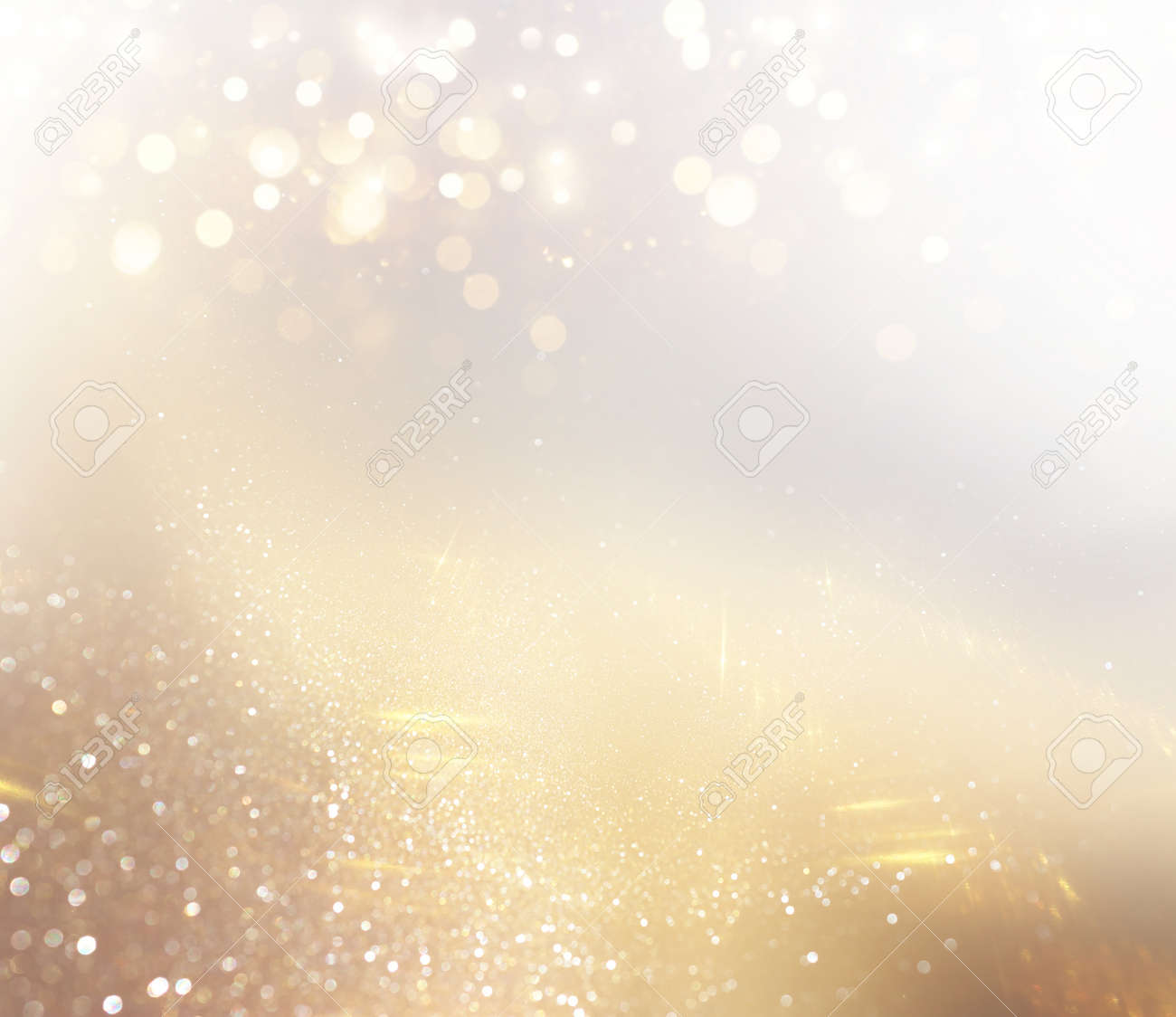 background of abstract gold and silver glitter lights. defocused - 169241659