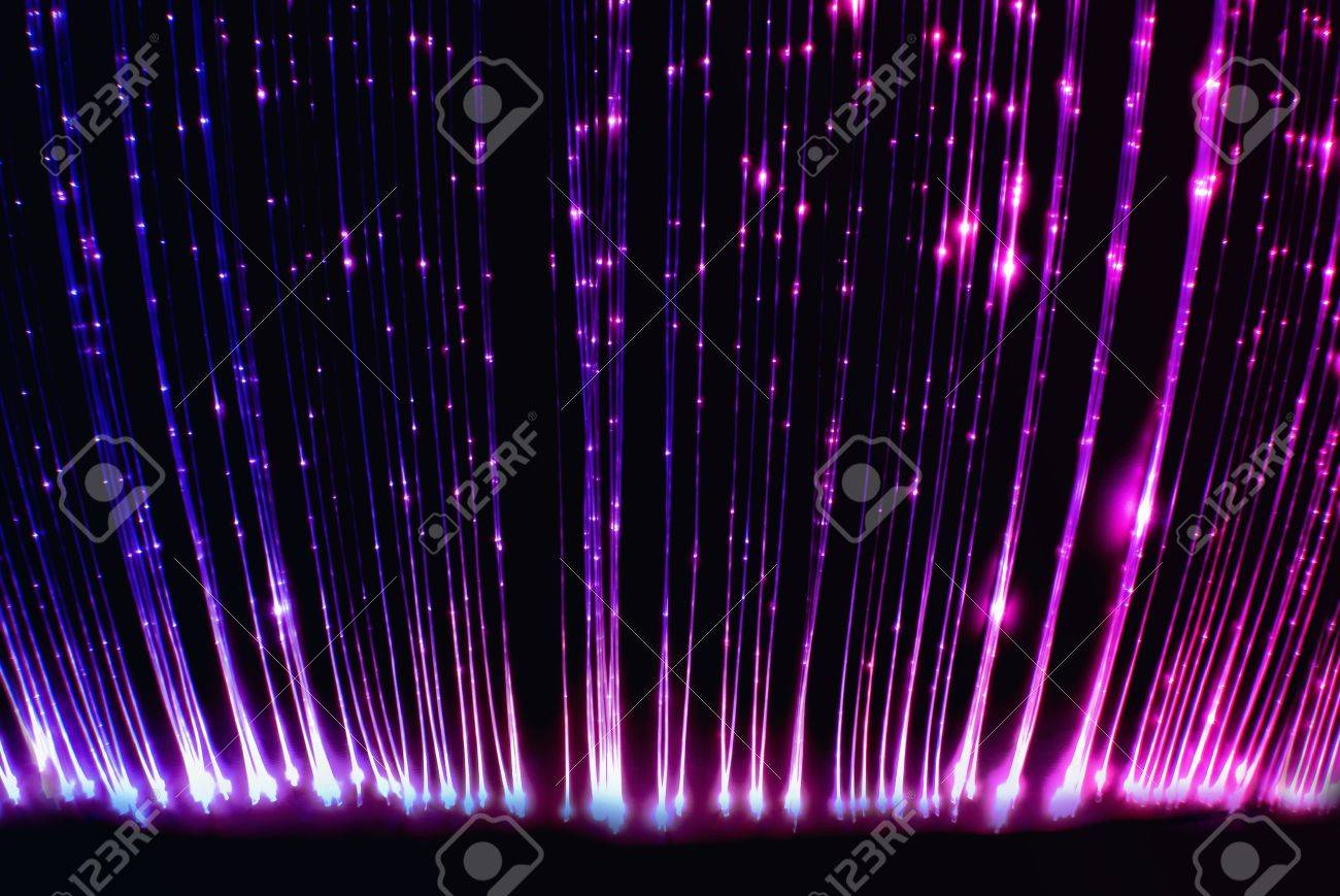 pink and purple fiber optic light cables stock photo picture and