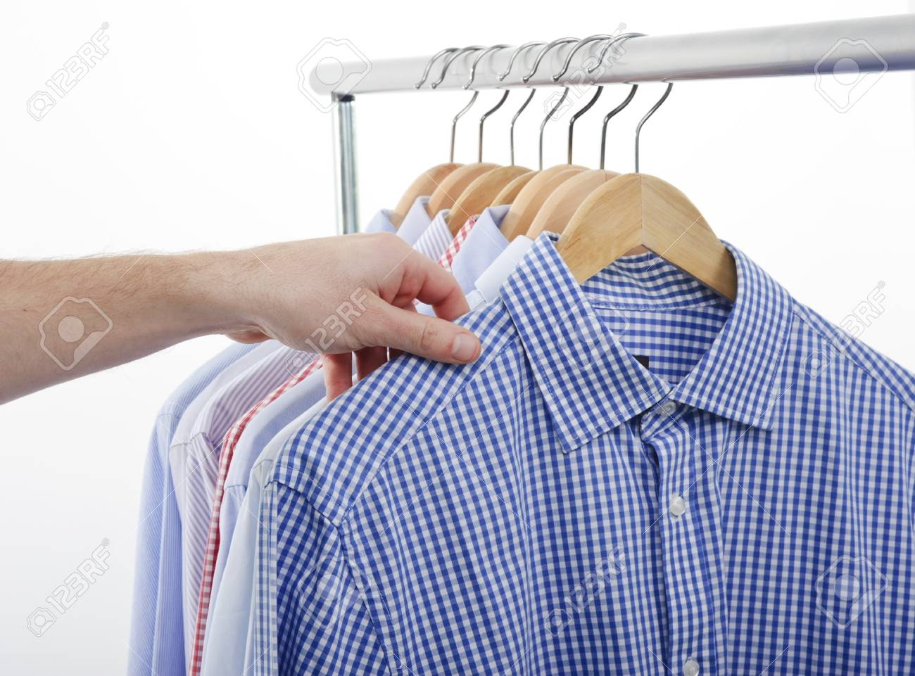 man choosing and taking his shirt Stock Photo - 11406001