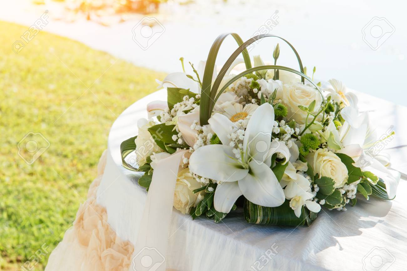 Wedding party decoration with flowers and white towel stock photo wedding party decoration with flowers and white towel izmirmasajfo