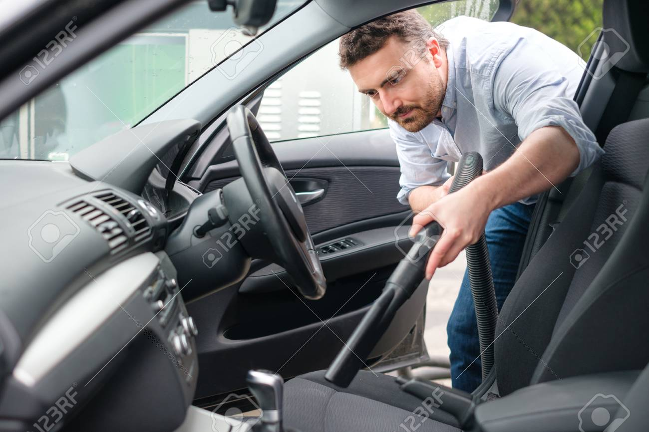 Man Vacuum Cleaning His Car Seats Interior Stock Photo Picture And