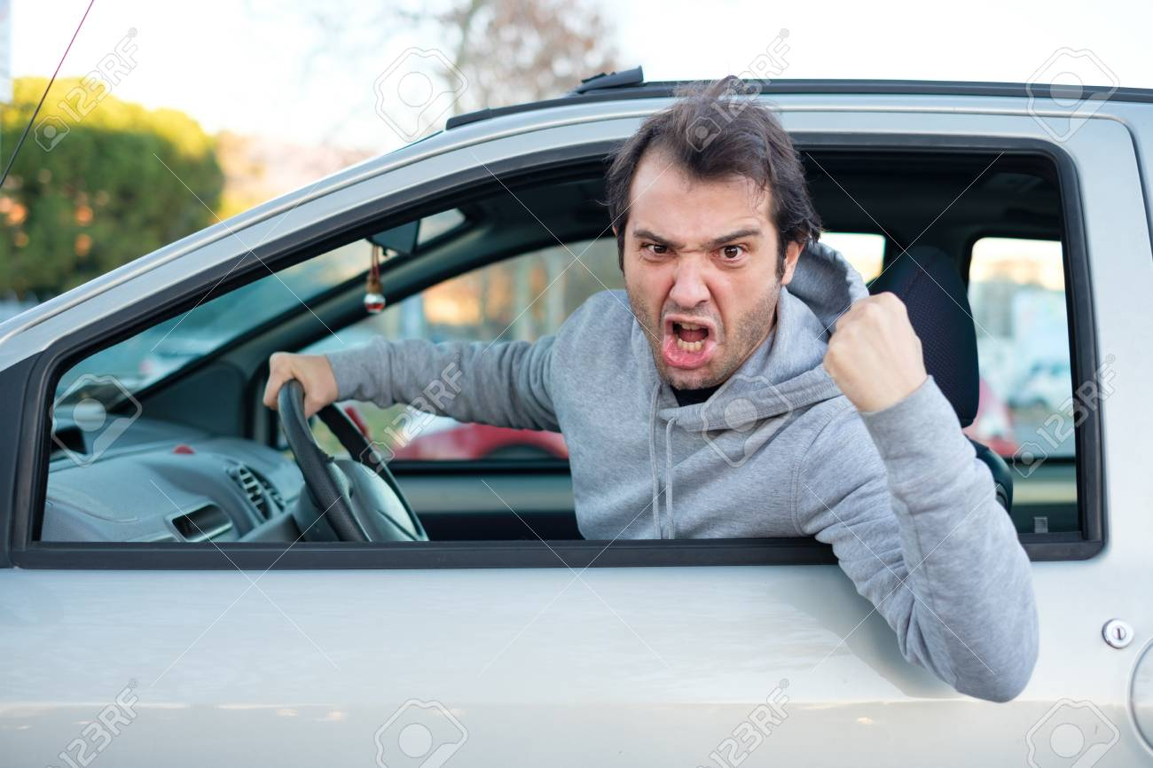 Portrait of angry driver at the wheel. Negative human emotions face expression - 91254916