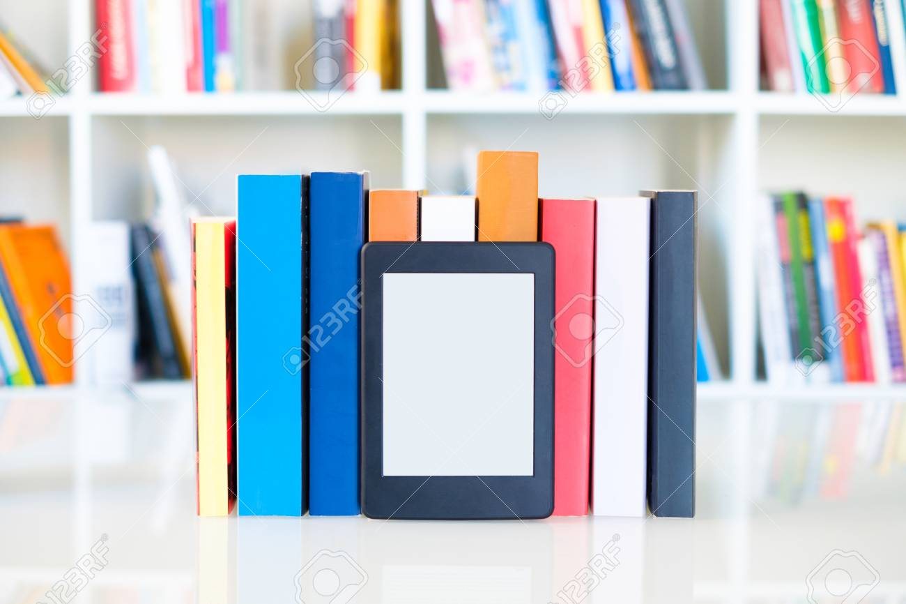 Ebook Reader And Paper Books On Bookshelf BackgroundCopy Space Digital Tablet Display Stock