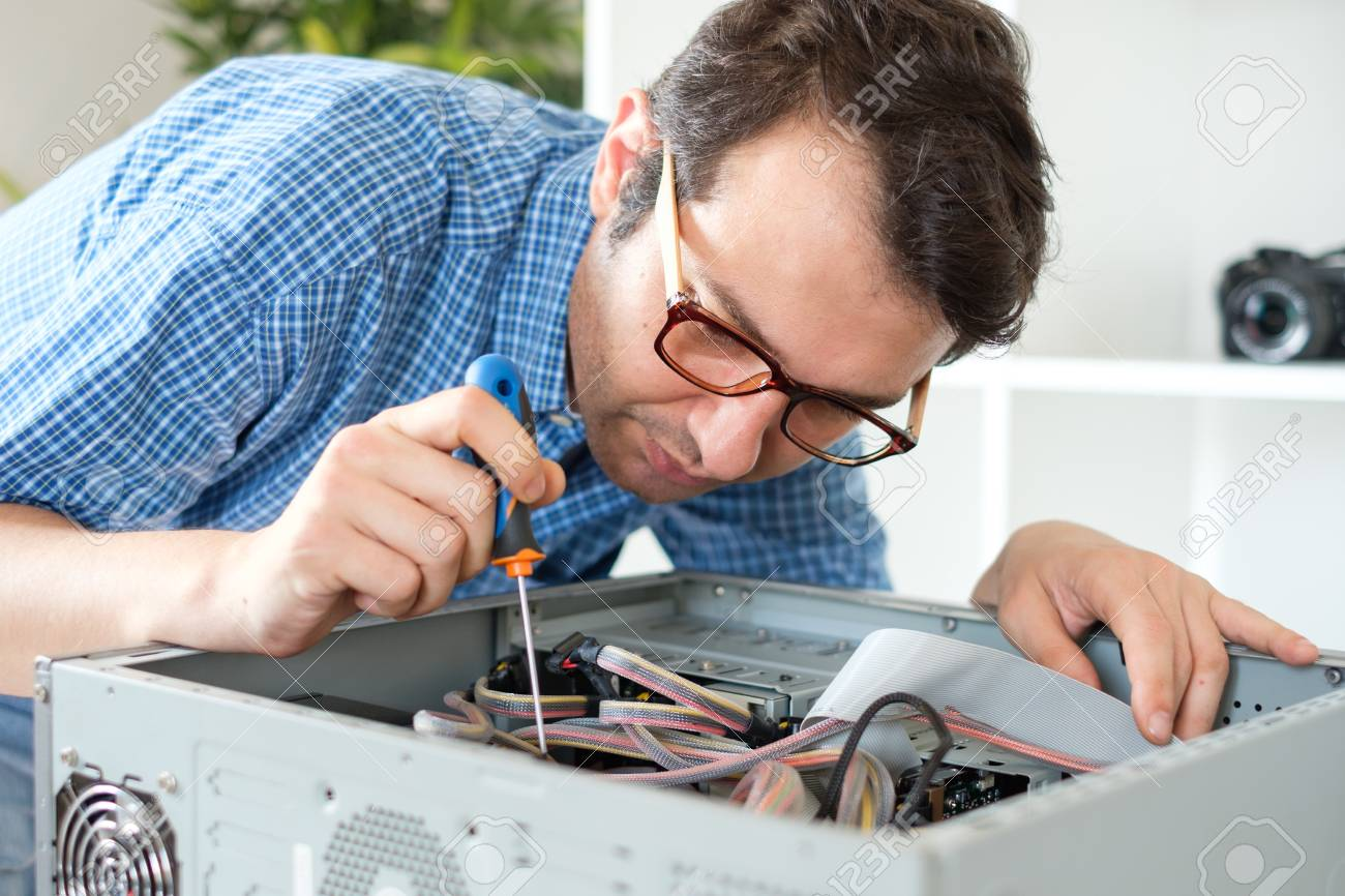 Engineer disassembling a computer internal parts in service center