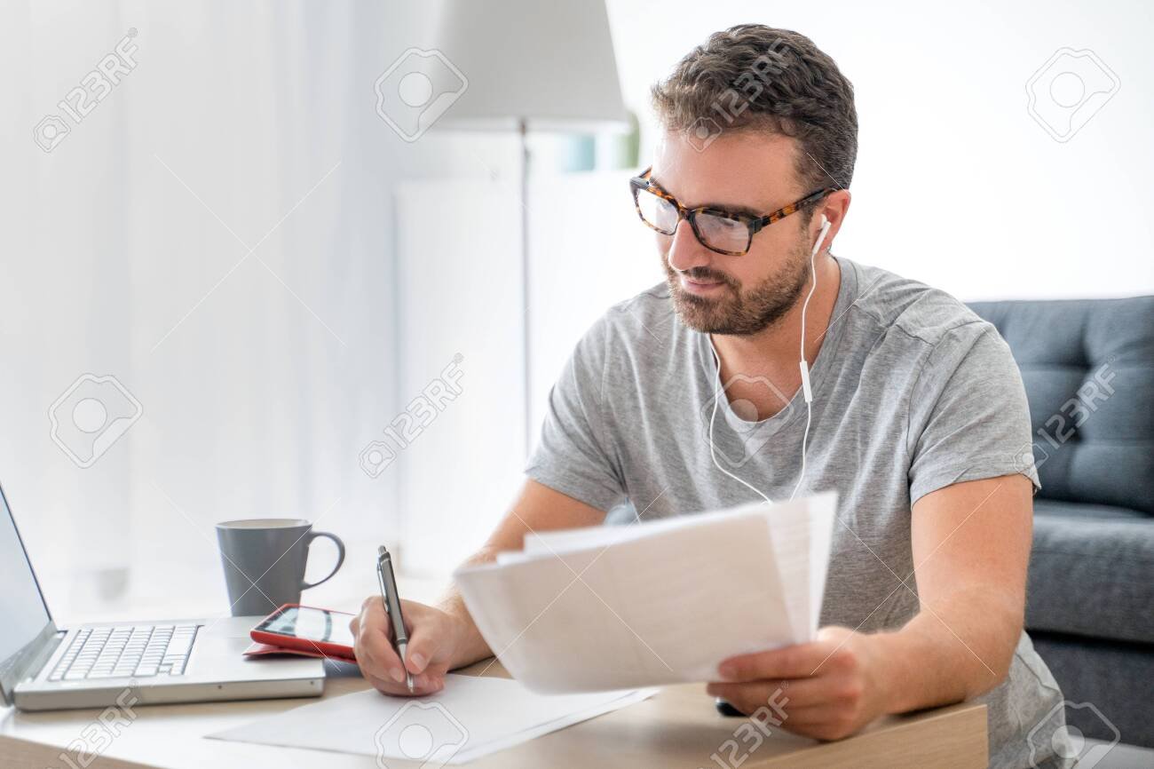 Man working from home using computer and internet connection - 154855338