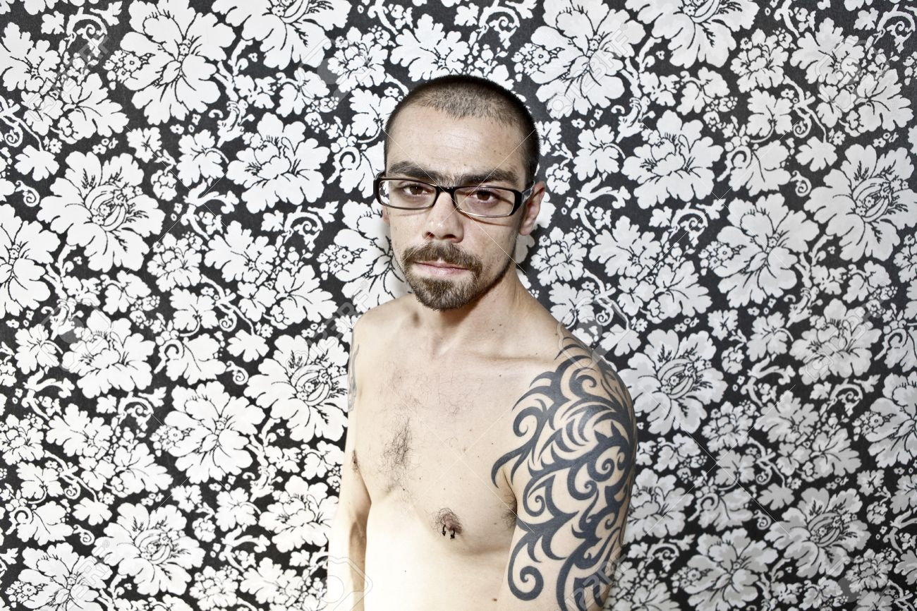 skinny tattoo guy on floral background Stock Photo - 9840562