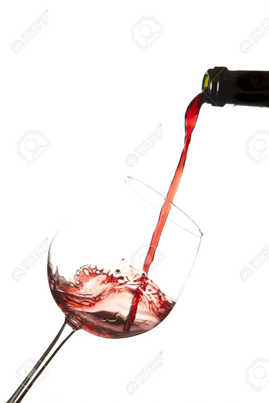 Red wine splash on a glass, white background. Stock Photo - 9733625