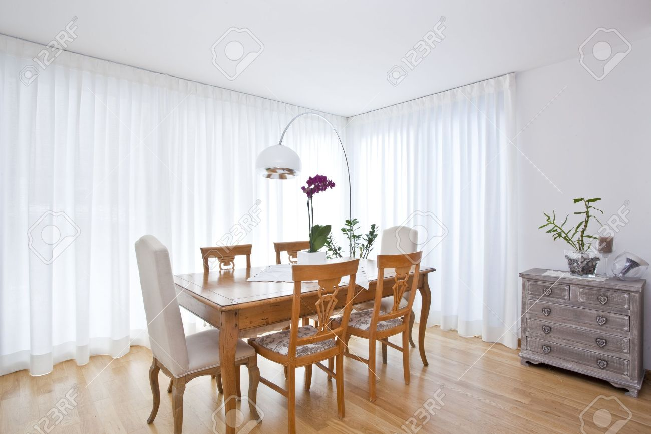 Modern white curtains - Stock Photo Modern Dining Room With White Curtains