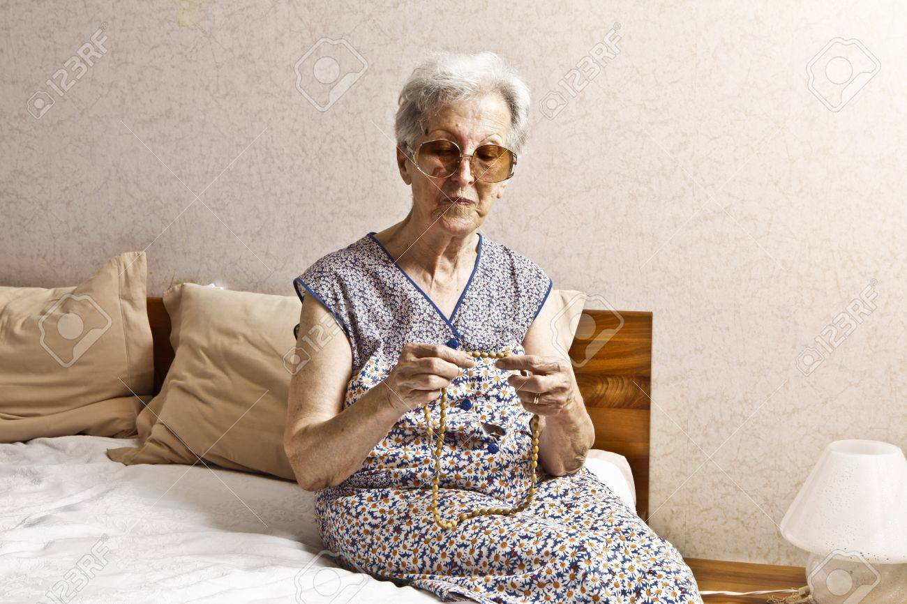 old lady in the bedroom Stock Photo - 9985881