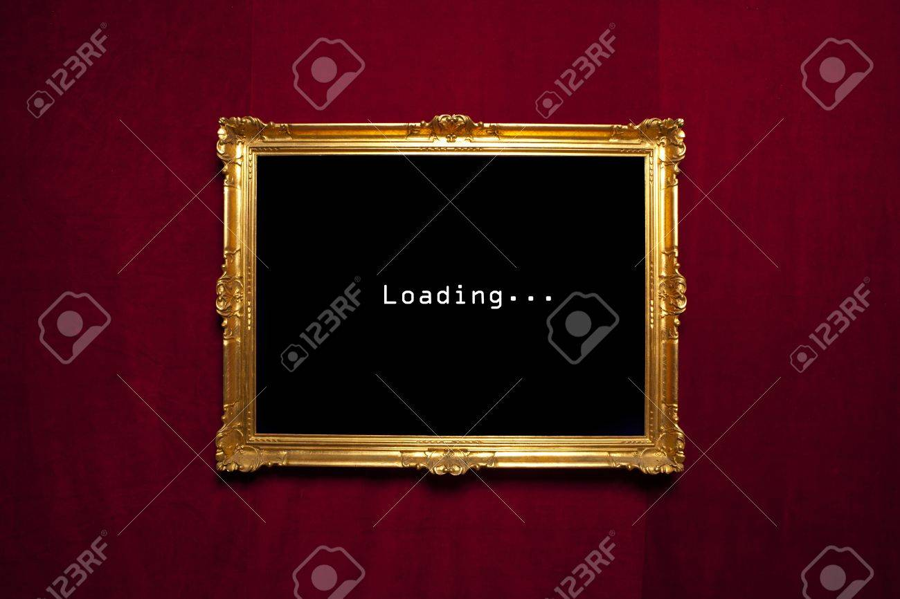 Antique Gold Frame With A Loading Sign On A Red Velvet Wall Stock ...