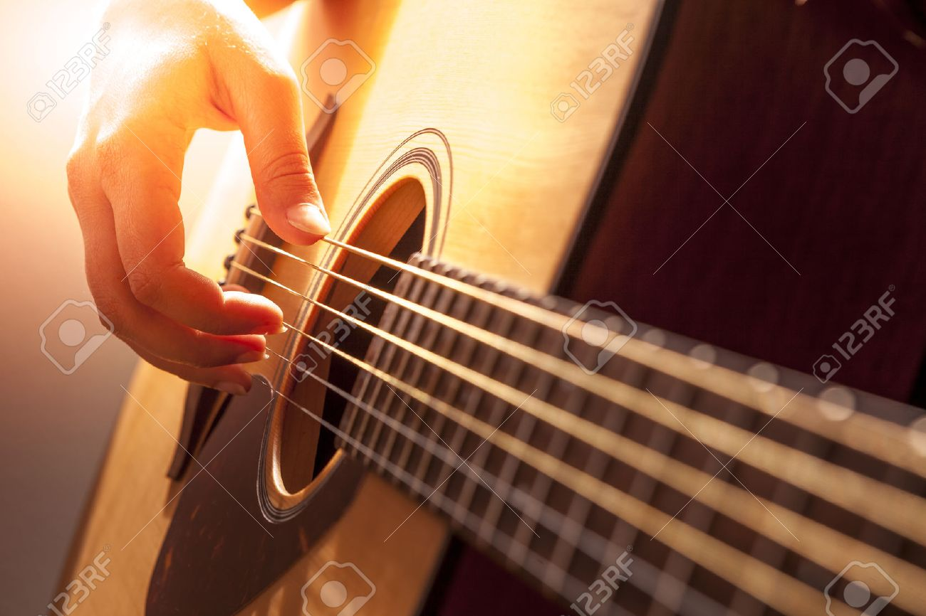 Womans Hands Playing Acoustic Guitar Close Up