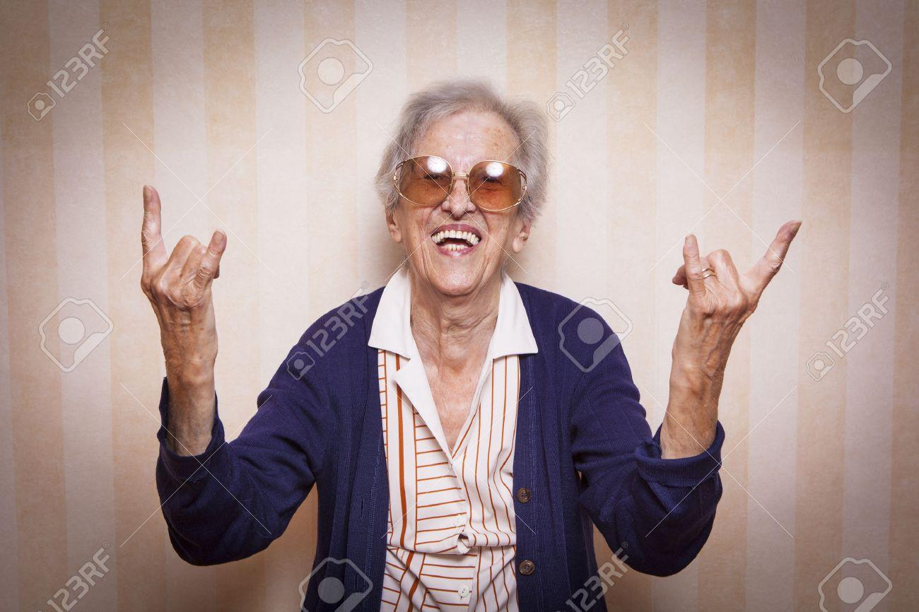 elder lady making rock on sign - 34826847