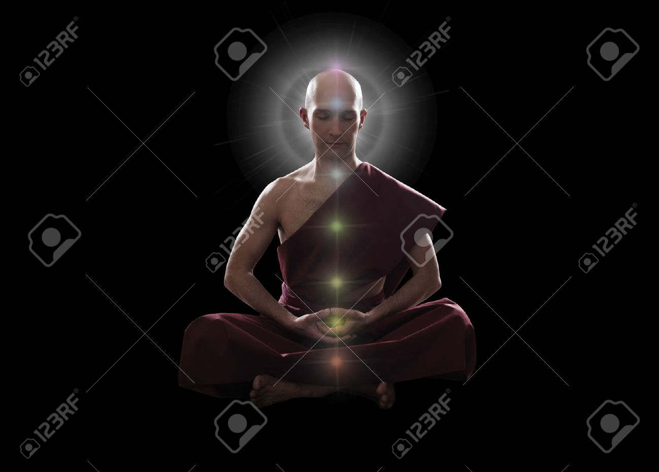 Buddhist Monk In Meditation Pose With Colorful Chakras Over Black Background Stock Photo