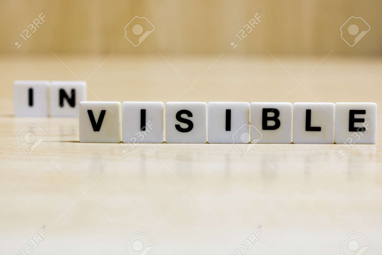 A row of small white plastic tiles, containing the letters forming the word visible, to represents the concept of seeing what was previously invisible. - 160483983