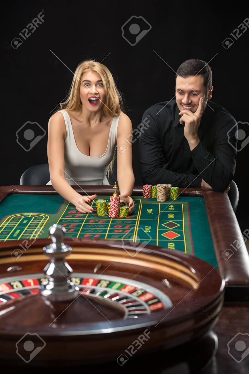 Couple Playing Roulette Wins At The Casino. Addiction To The Gambling Stock  Photo, Picture And Royalty Free Image. Image 51210917.