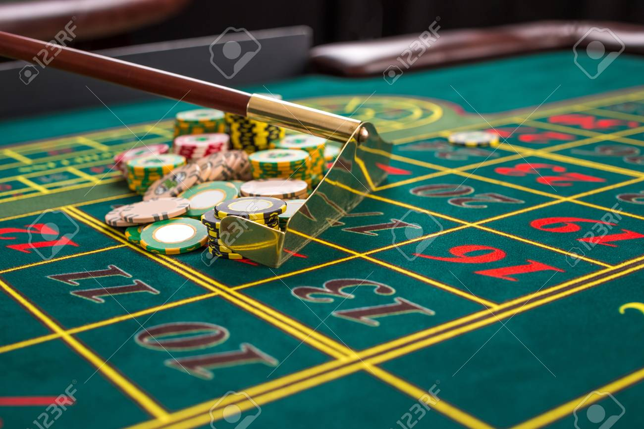Close Up Of Gambling Chips On A Green Table In Casino. Croupier.. Stock  Photo, Picture And Royalty Free Image. Image 51318929.