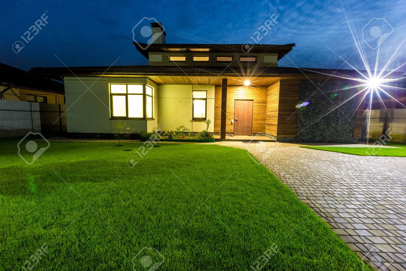 Detached Luxury House At Night   View From Outside Front Entrance.  Architecture Modern Design,