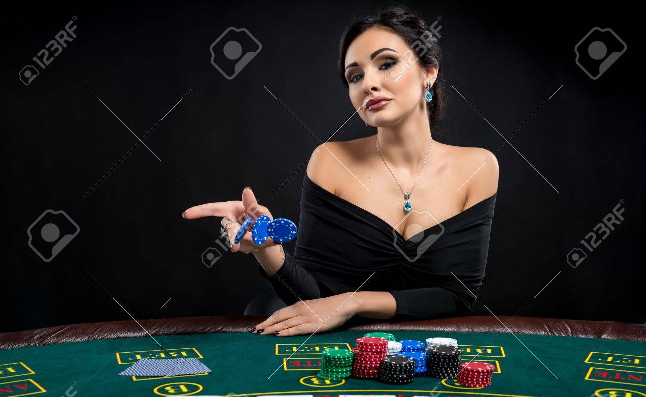 sexy woman with poker cards and chips. Female player in a beautiful black  dress.