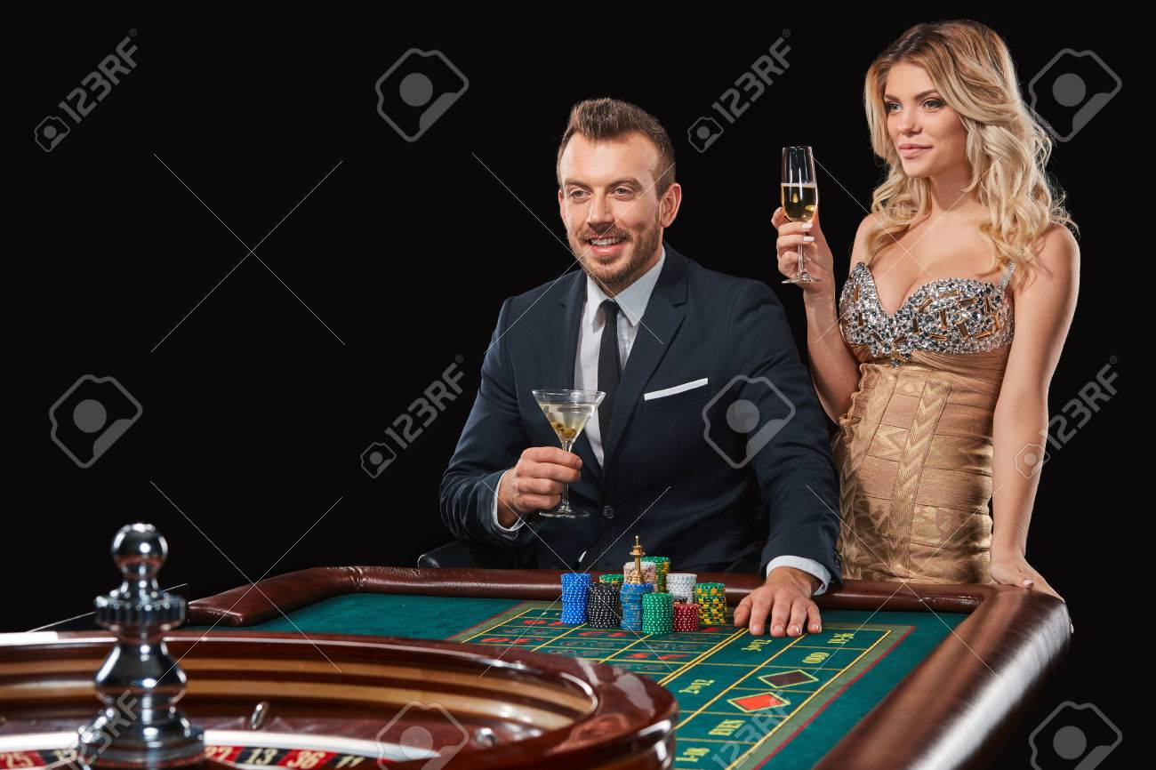 Couple Playing Roulette Wins At The Casino. Addiction To The Gambling.  Happy Win Stock Photo, Picture And Royalty Free Image. Image 66401482.