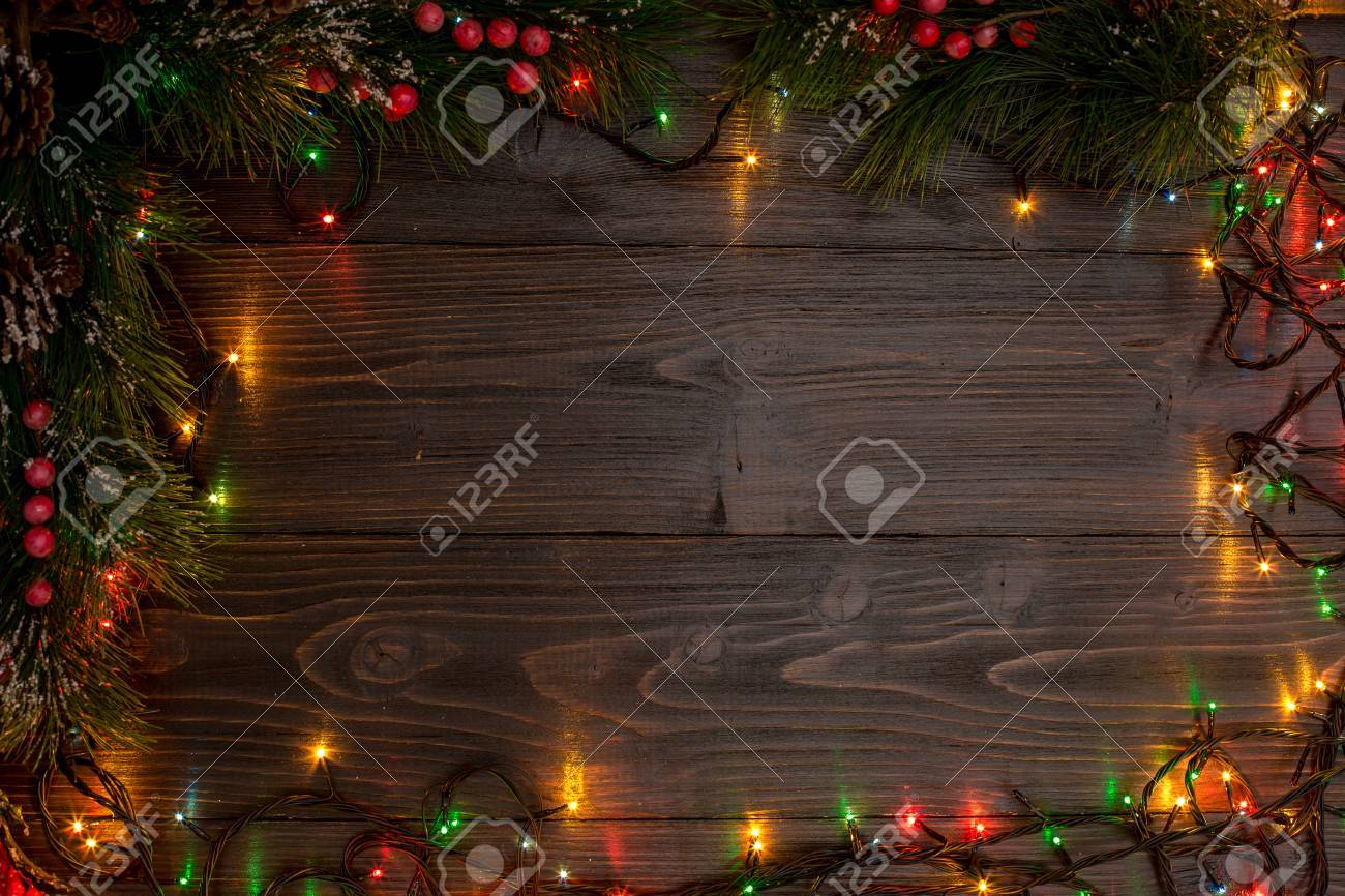 New Year And Christmas Mokcup Xmas Lights On Wooden Background Space For Your Text