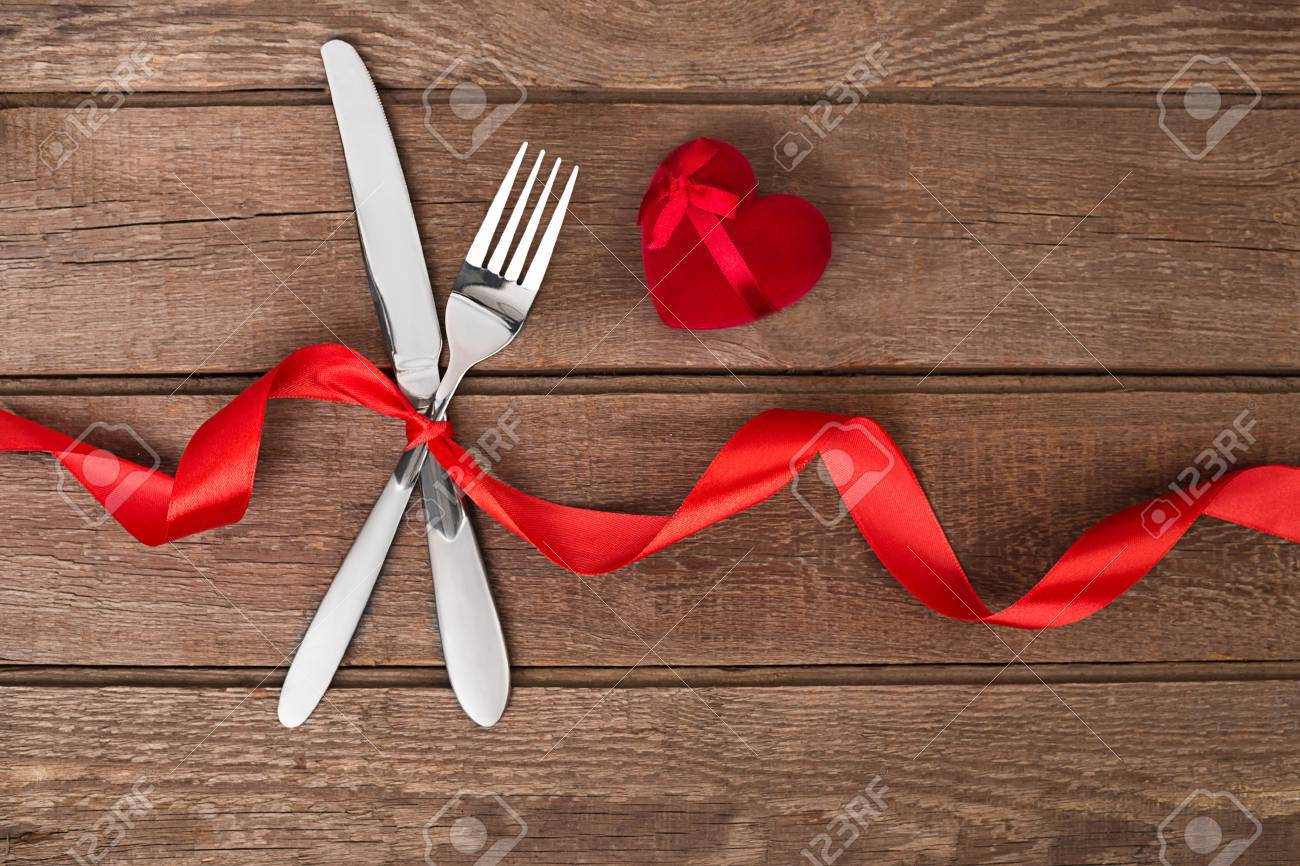 Valentines Day Dinner Table Setting With Red Ribbon Knife And