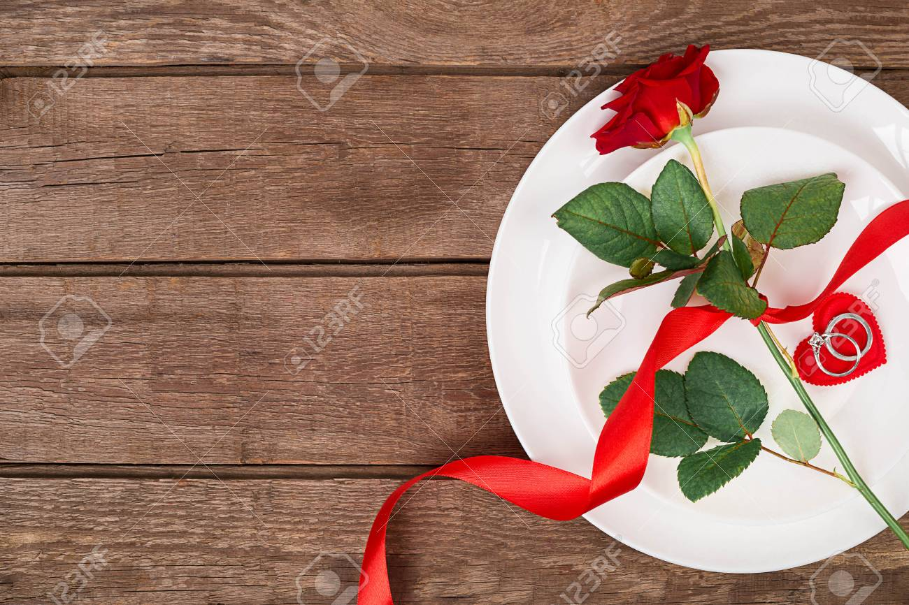 Valentines Day Dinner Table Setting With Red Ribbon Rose And