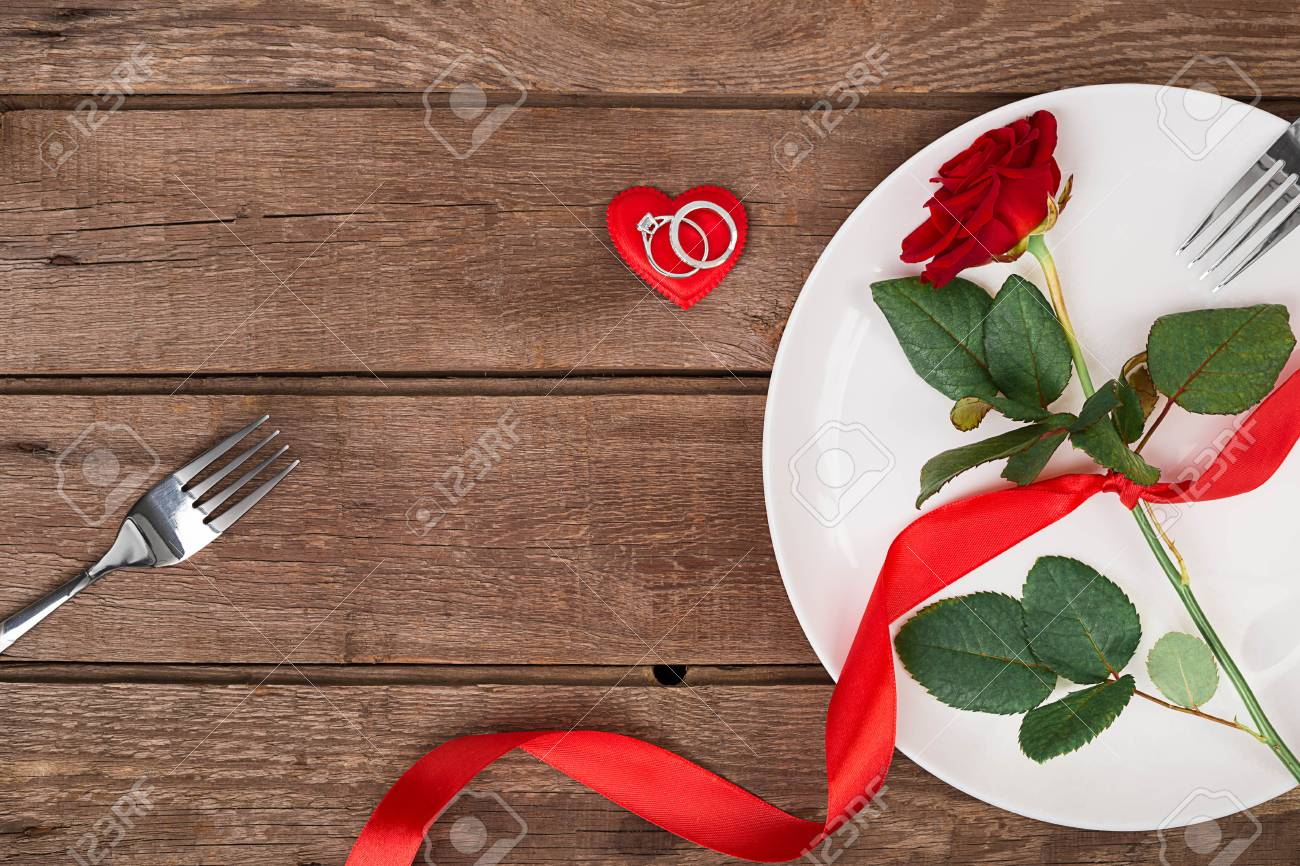 Valentines Day Dinner Table Setting With Red Ribbon Rose Knife