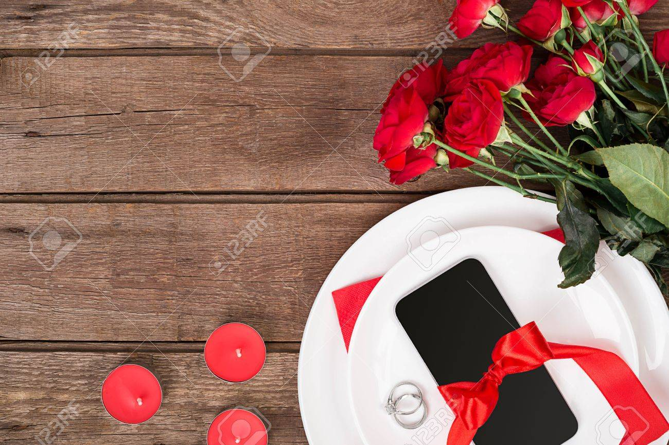 Valentines Day Dinner Table Setting With Red Ribbon Roses Knife