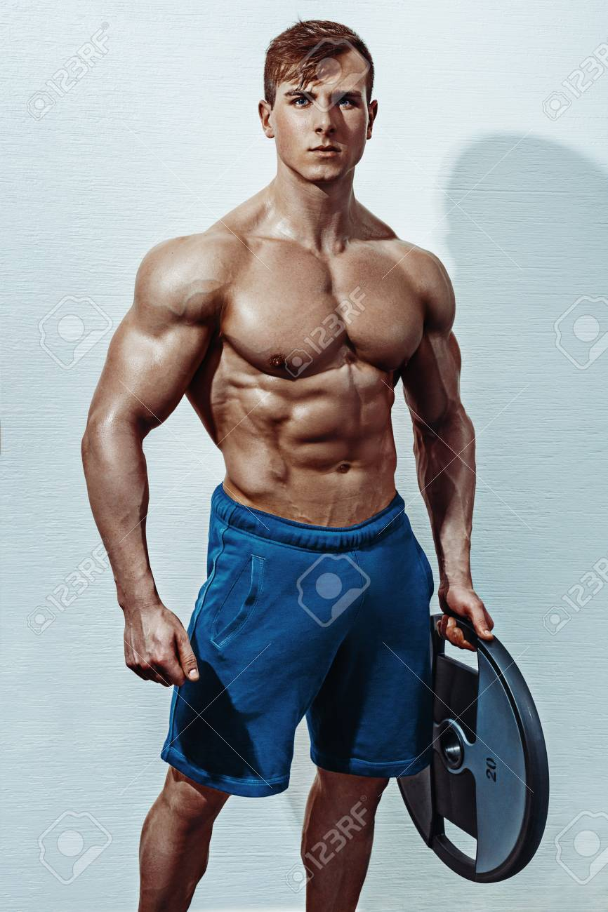 outlet store 09fcc 468bf Male bodybuilder, fitness model trains in the gym. Handsome male..