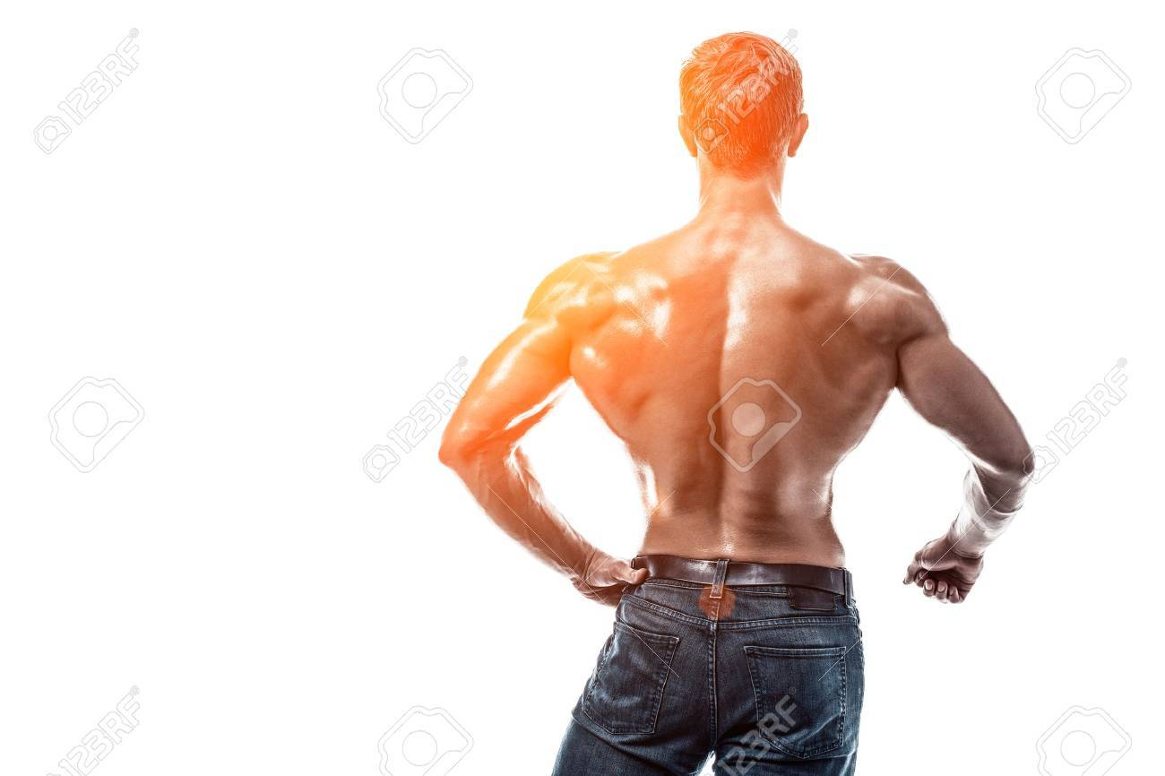 Starke Athletic Man Fitness Modell Posiert Rücken Muskeln, Trizeps O ...