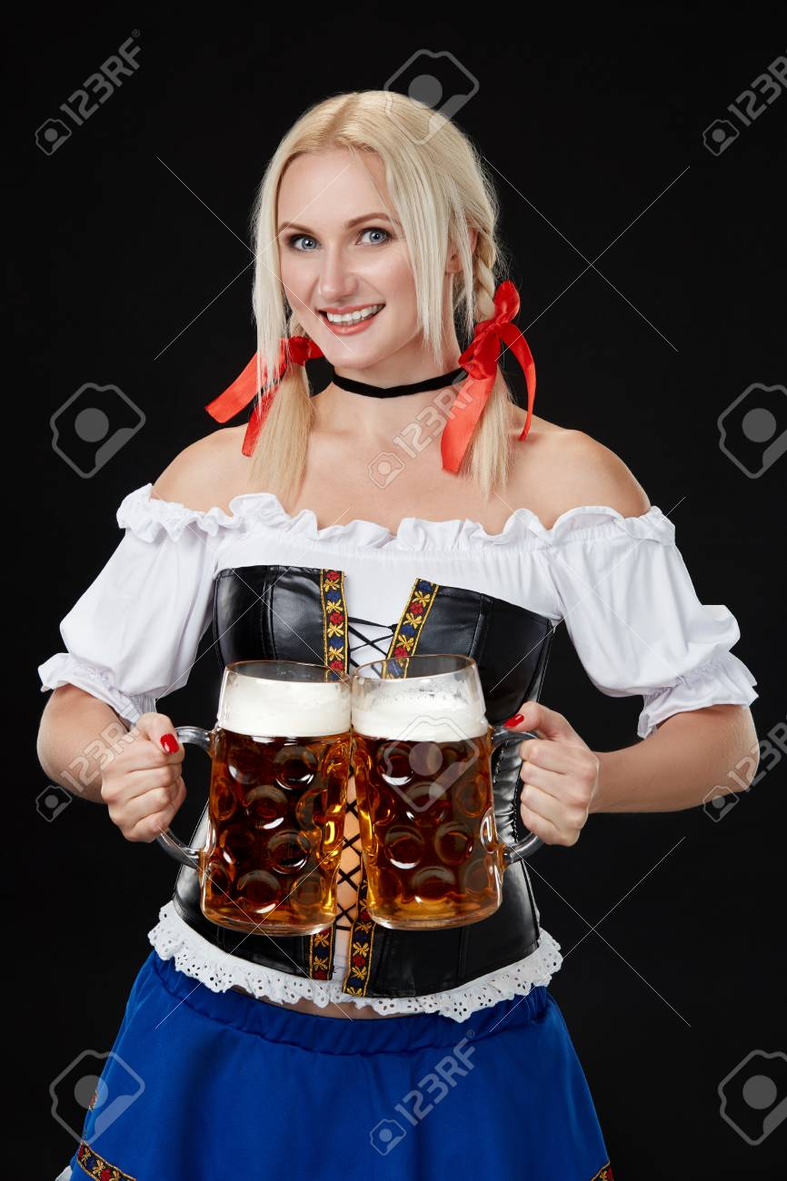 Stock Photo - Young sexy woman wearing a dirndl with two beer mugs on black background  sc 1 st  123RF.com & Young Sexy Woman Wearing A Dirndl With Two Beer Mugs On Black ...