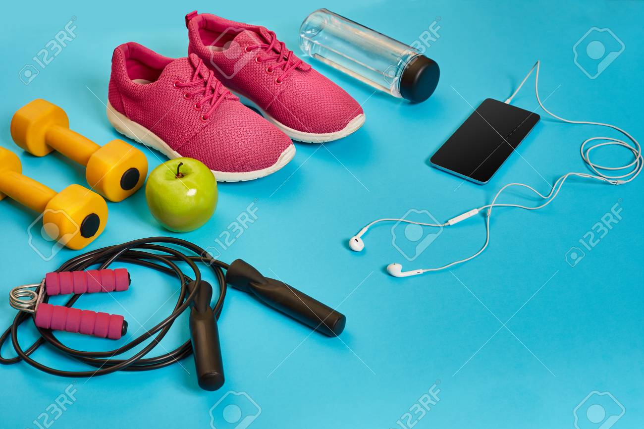 Flat Lay Of Dumbbell, Bottle Of Water, Jump Rope And Sneaker ...