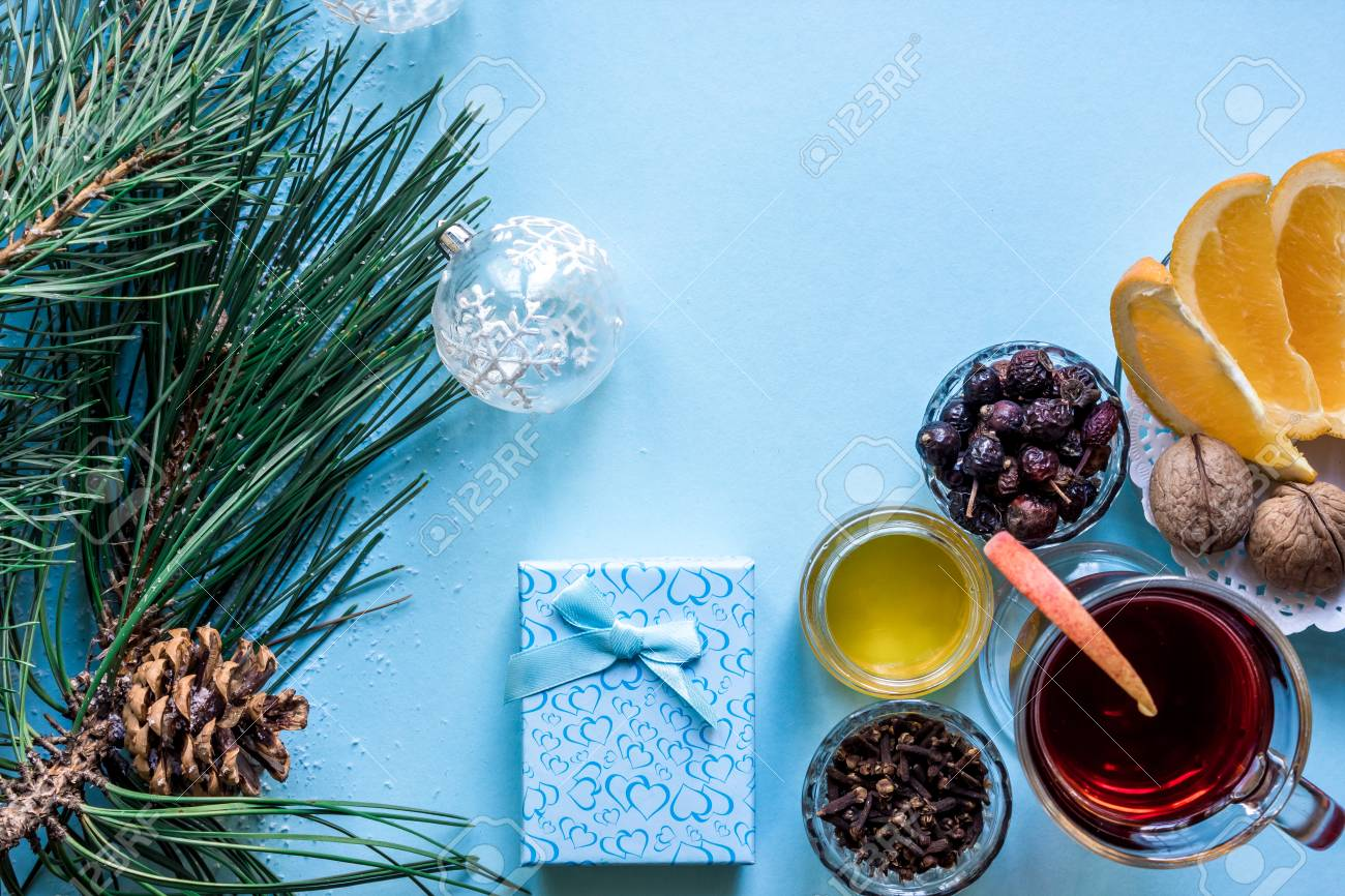 hot mulled wine with orange anise cardamon and cinnamon on blue background christmas