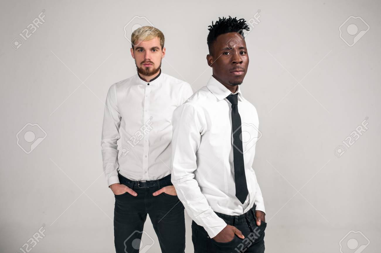 Friends Two Guys In White Shirts And Dark Pants Posing In The Stock Photo Picture And Royalty Free Image Image 94367453